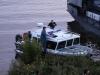 Полицеский катер привез губернатора края на пристань близ моста на ул. Пионерской